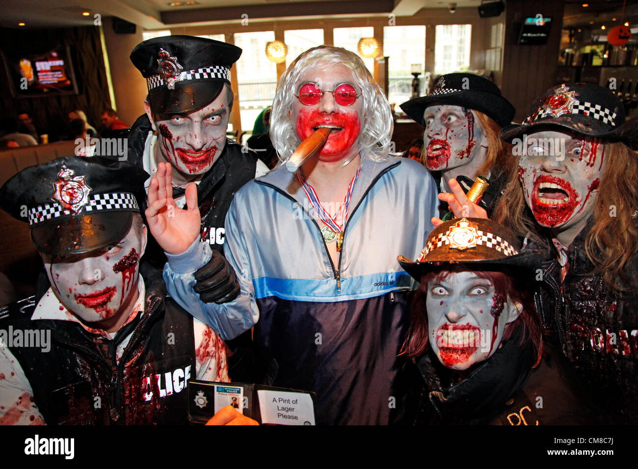 London, UK. 27th October 2012. People Dressed Up As Police Zombies With An