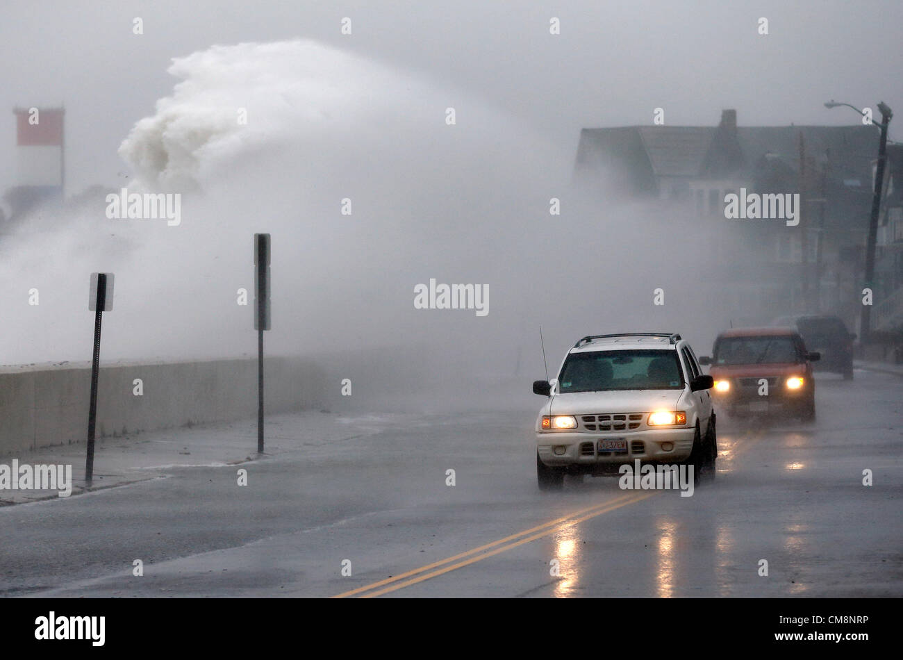 Winthrop, Massachusetts, USA. Waves driven by high winds from Hurricane Sandy crash over the seawall in Winthrop, - Stock Image