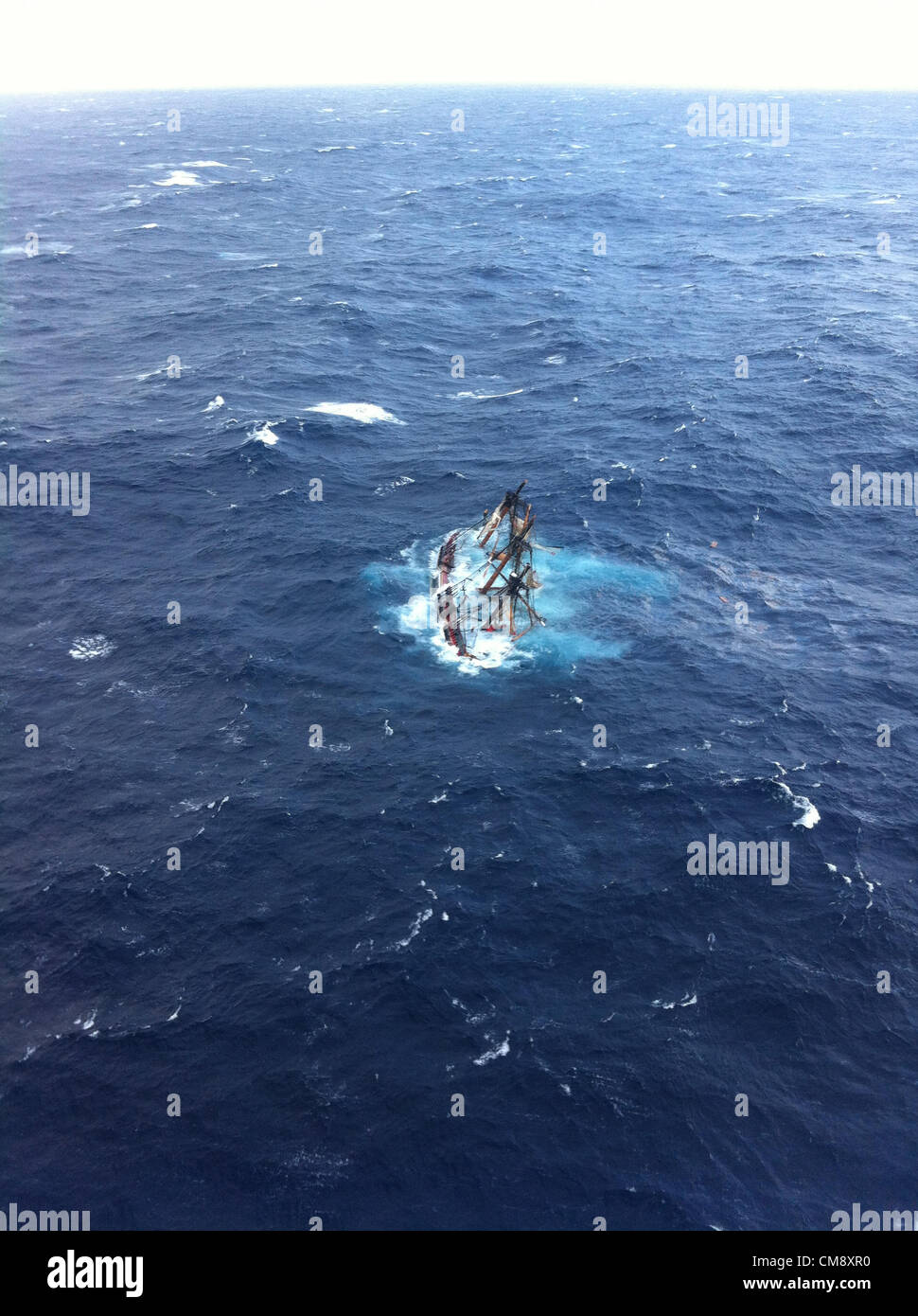 The HMS Bounty, a 180-foot sailboat, is shown submerged in the Atlantic Ocean during Hurricane Sandy approximately - Stock Image