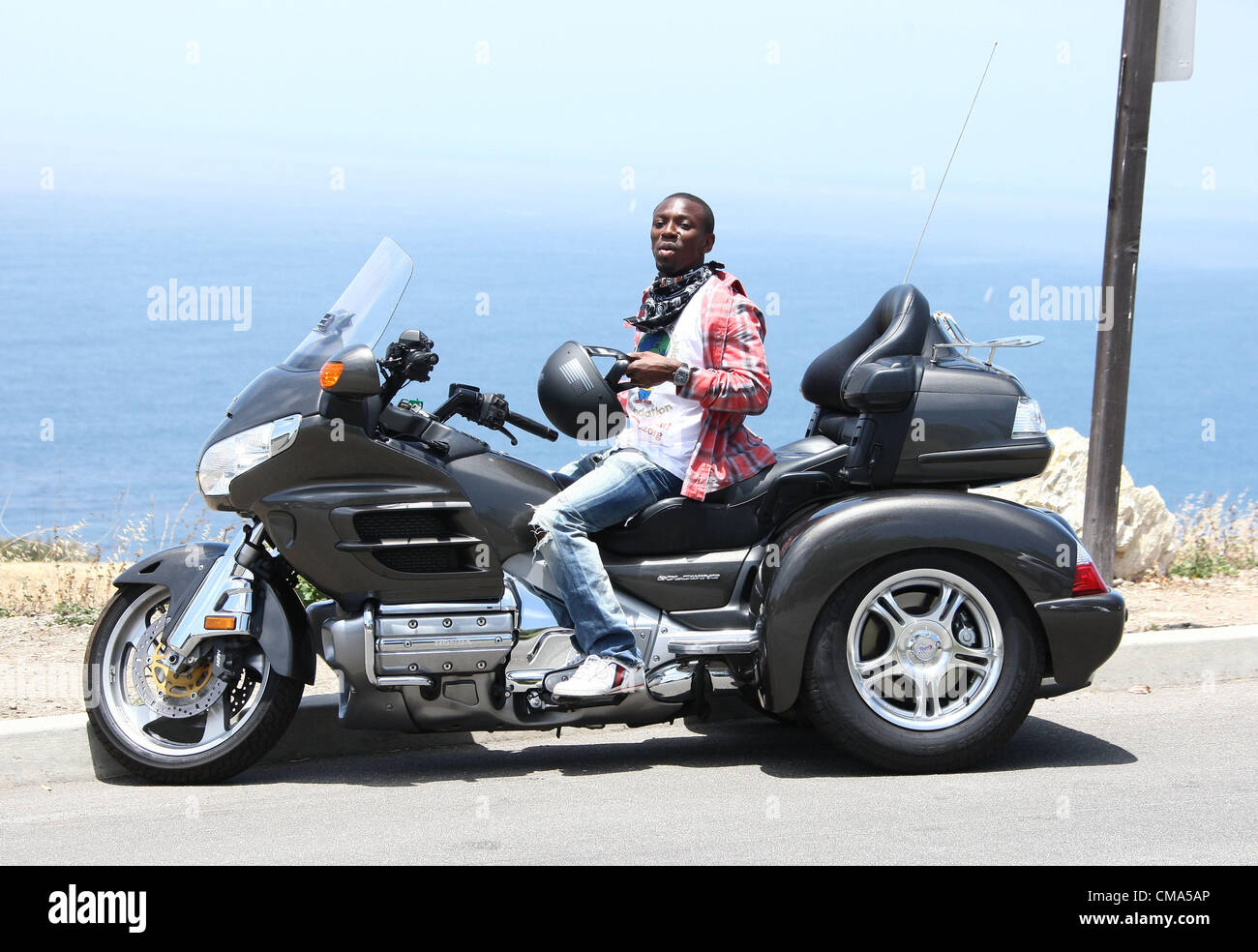 Shaun Wright-Phillips riding on a Harley Davidson - Stock Image