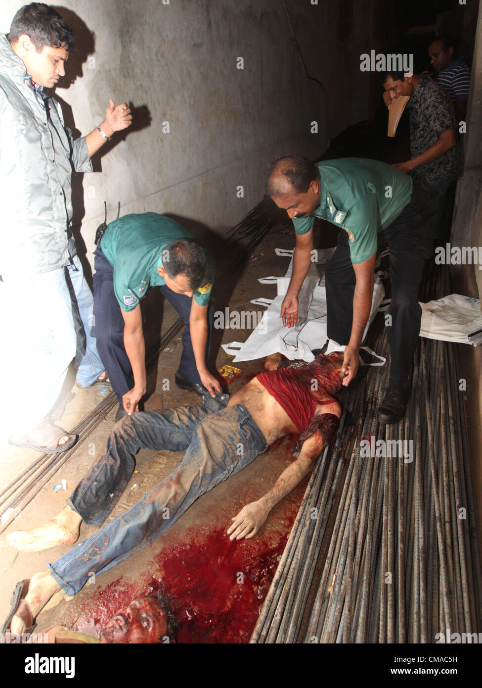 July 4, 2012 - Dhaka, Bangladesh - Bangladeshi Police recover two dead bodies form the spot at midnight. Top listed - Stock Image