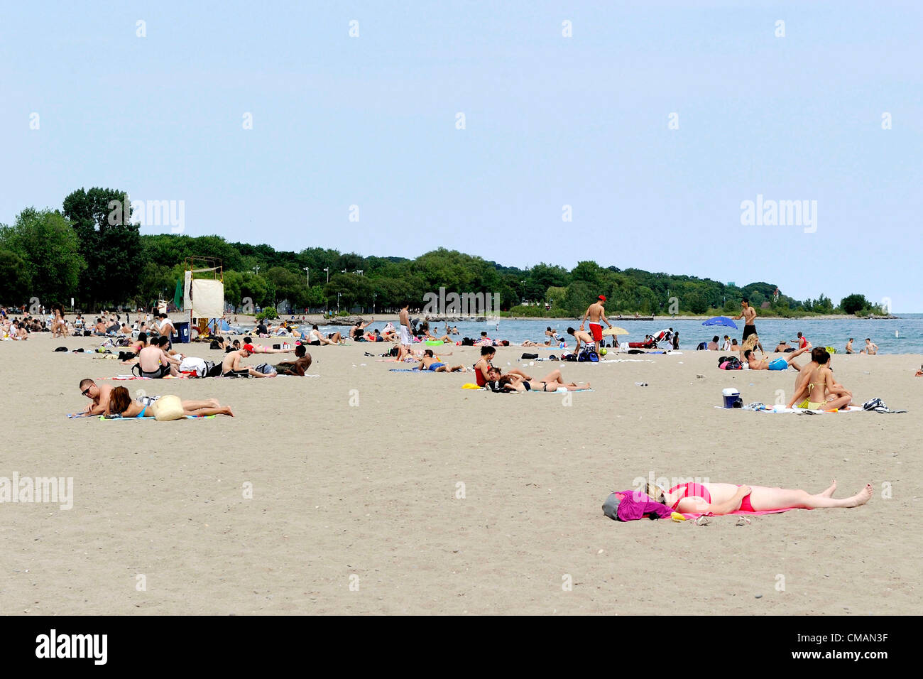 July 5, 2012 - Toronto, Canada - After a record breaking day yesterday in Toronto, beach goers continue to cool - Stock Image