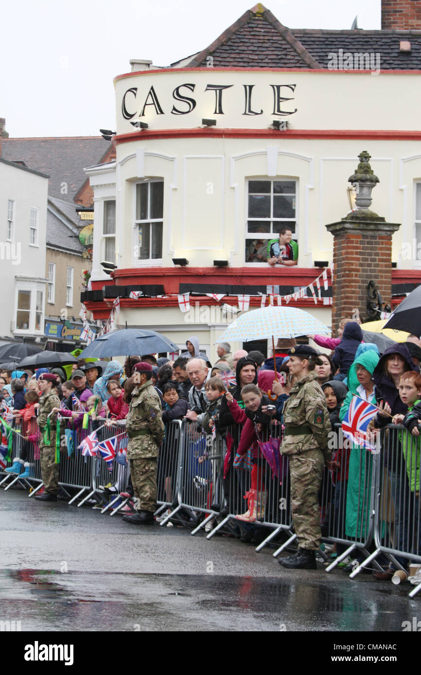 People of Colchester on the rain waiting for the Olympic Torch bearer in Cowdray Crescent, near the castle, in Colchester, - Stock Image
