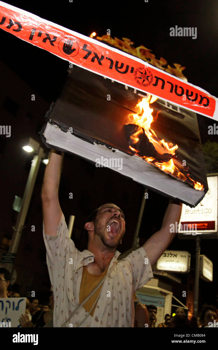 Israeli demonstrators shouting anti government slogans and burning placards they were carrying during Cost of Living - Stock Image