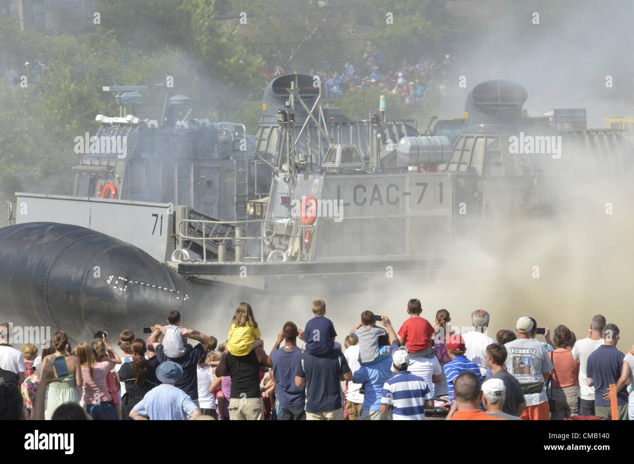 Niantic, Connecticut, July 6, 2012 - A crowd at McCook's Point Park watches a United States Navy hovercraft - Stock Image