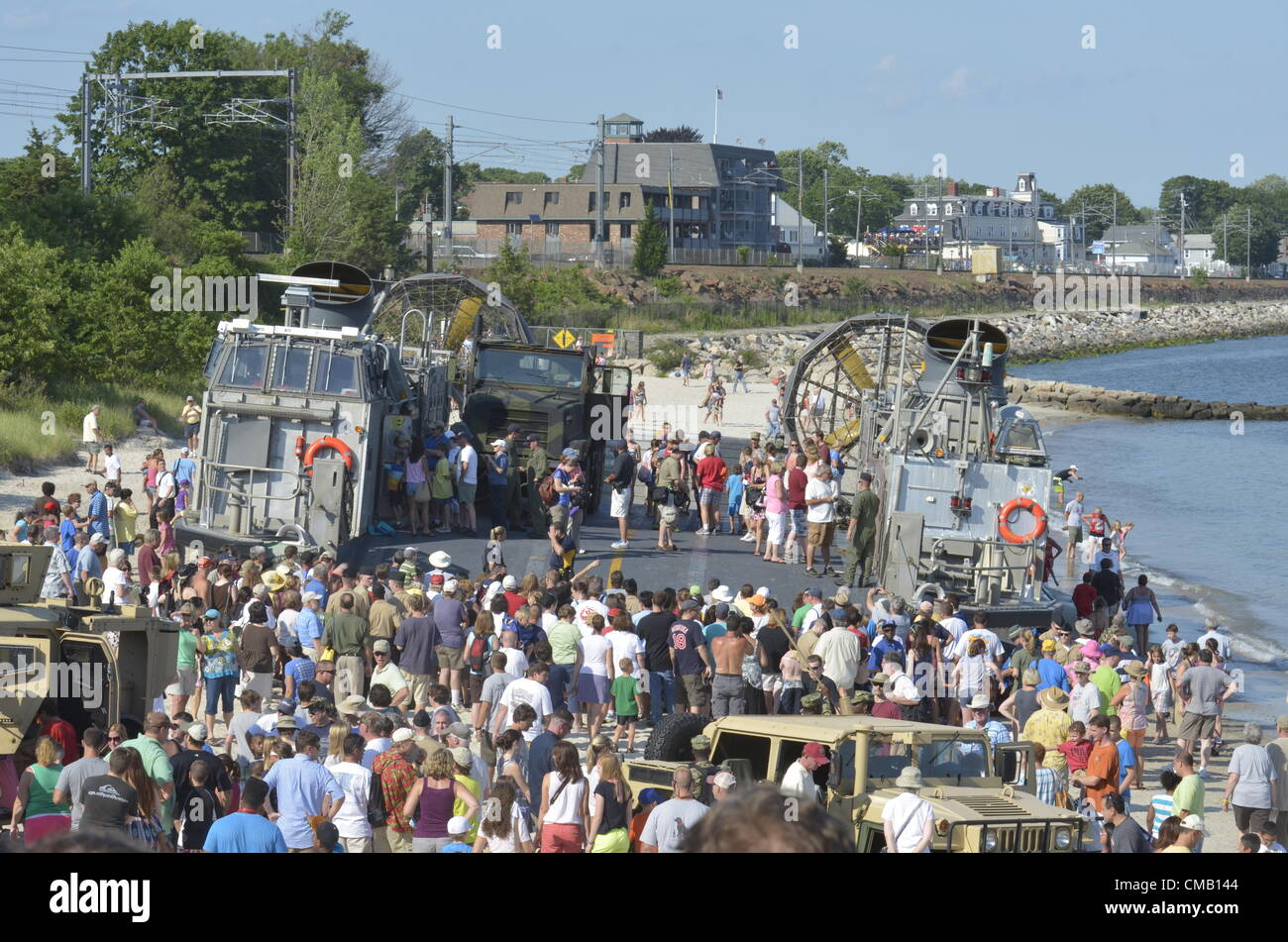 Niantic, Connecticut, July 6, 2012 -Crowds gather at Hole-in-the-Wall Beach for a chance to explore a US Navy LCAC - Stock Image