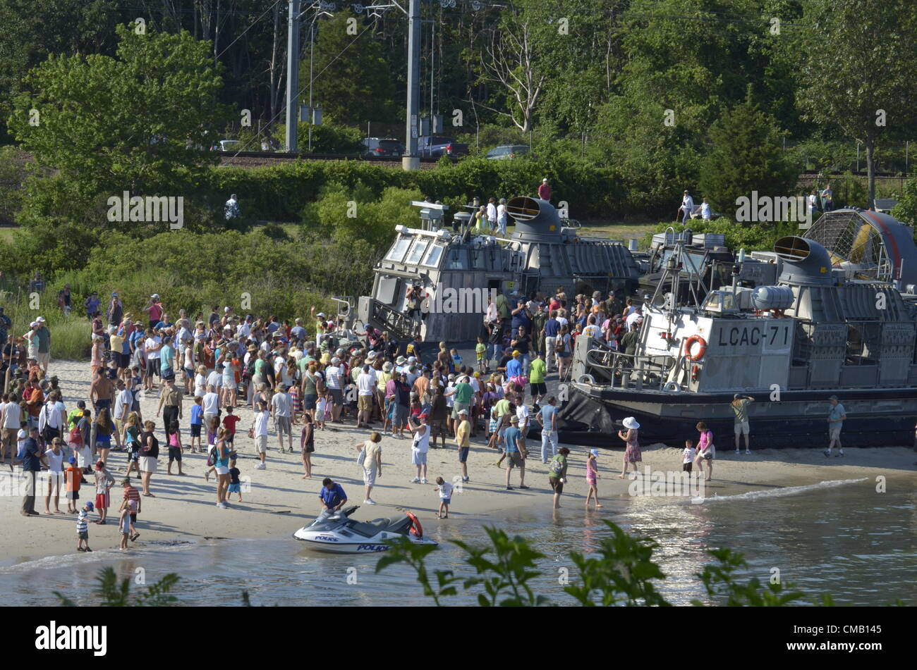 Niantic, Connecticut, July 6, 2012 - Crowds at Hole-in-the-Wall Beach explore a Navy hovercraft LCAC (Landing Craft - Stock Image