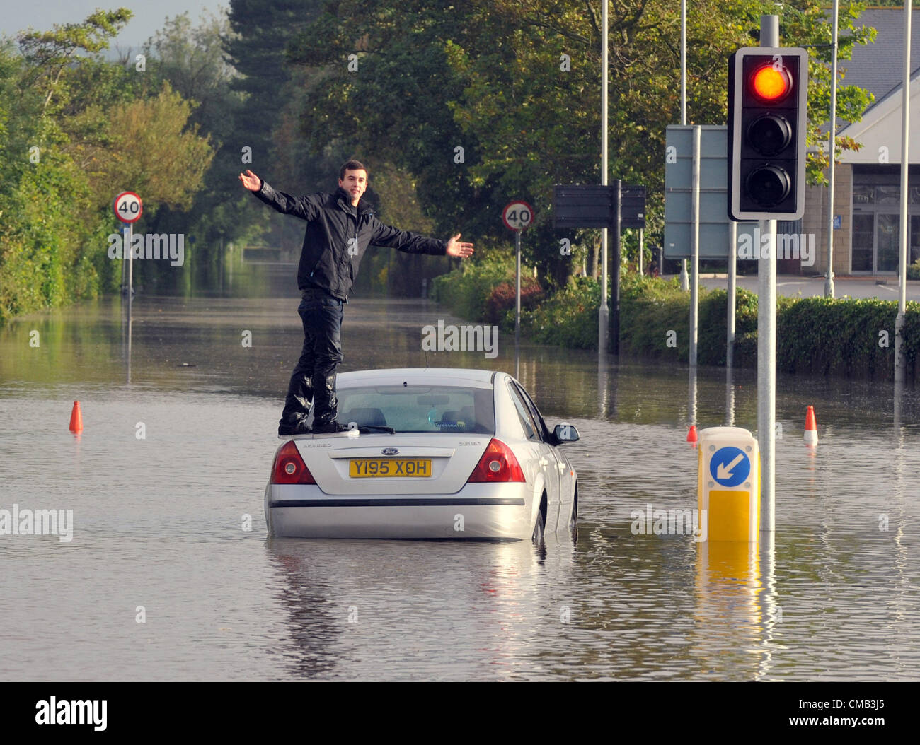 Dorset, UK. 8th July 2012.One young driver got caught out by the floods in the town centre at Weymouth. - Stock Image