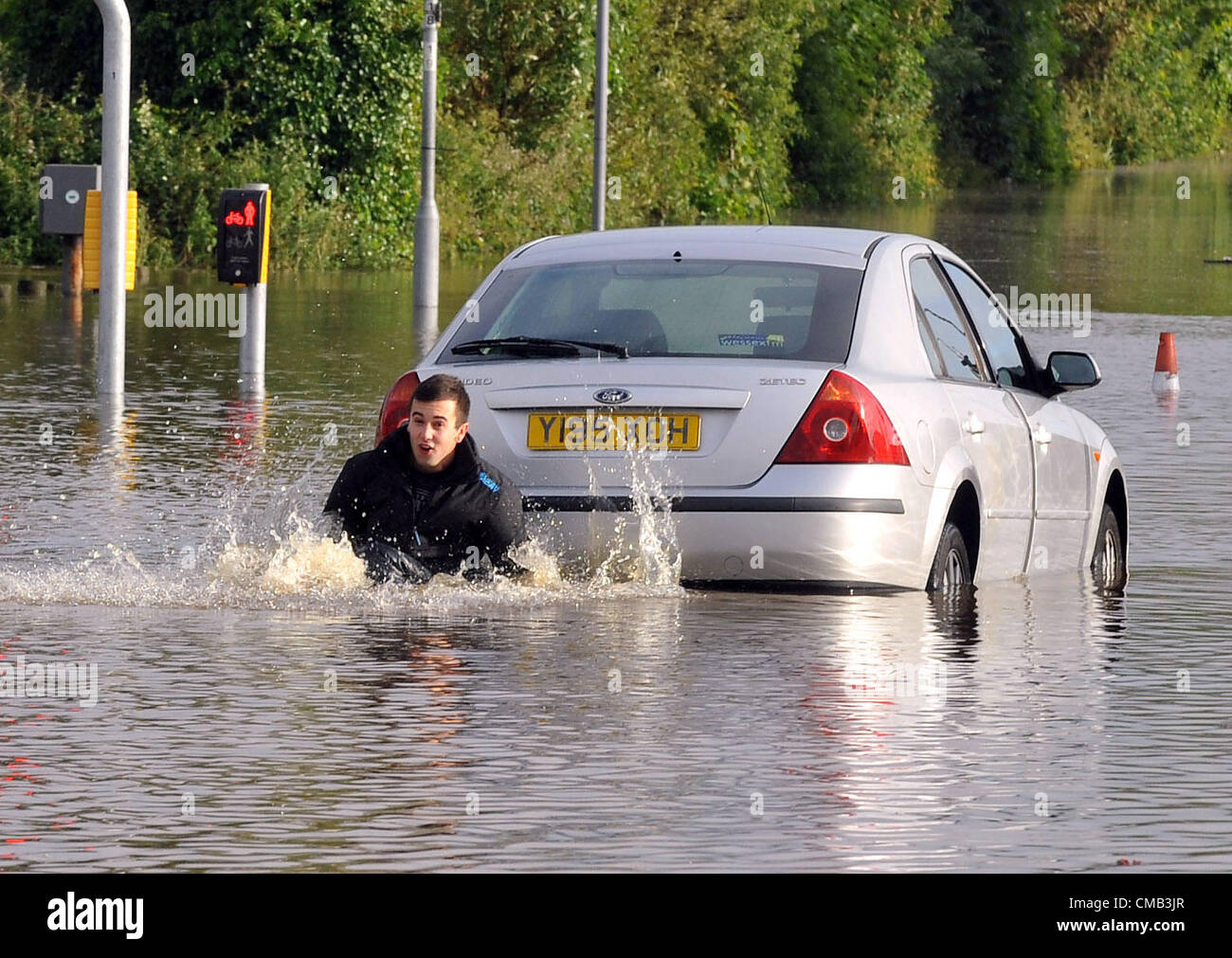 Dorset, UK. 8th July 2012. One young driver got caught out by the floods in the town centre at Weymouth. - Stock Image