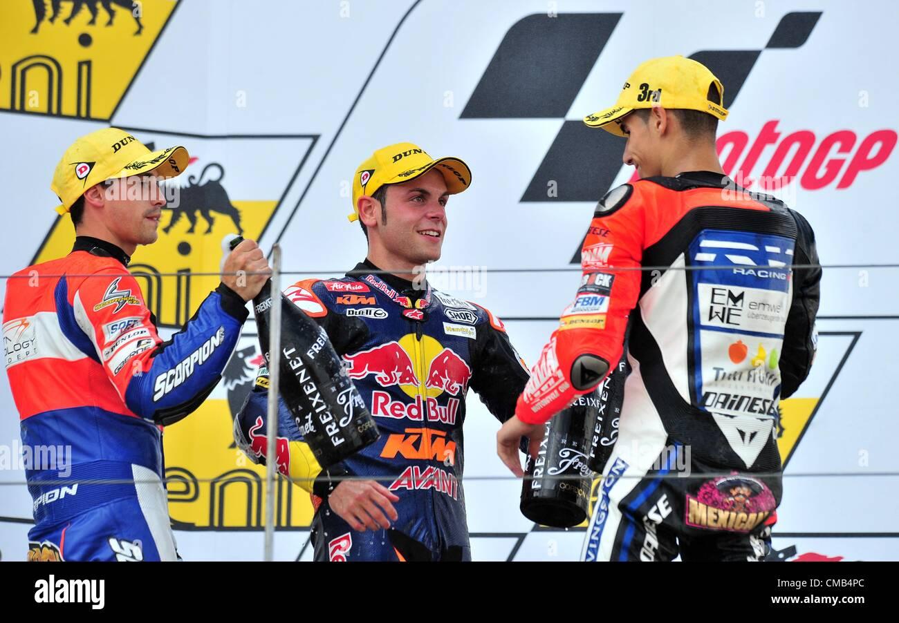 08.07.2012. Hohenstein-Ernstthal, Germany. German rider Sandro Cortese of Team Red Bull KTM (C) wins the Moto3 race Stock Photo