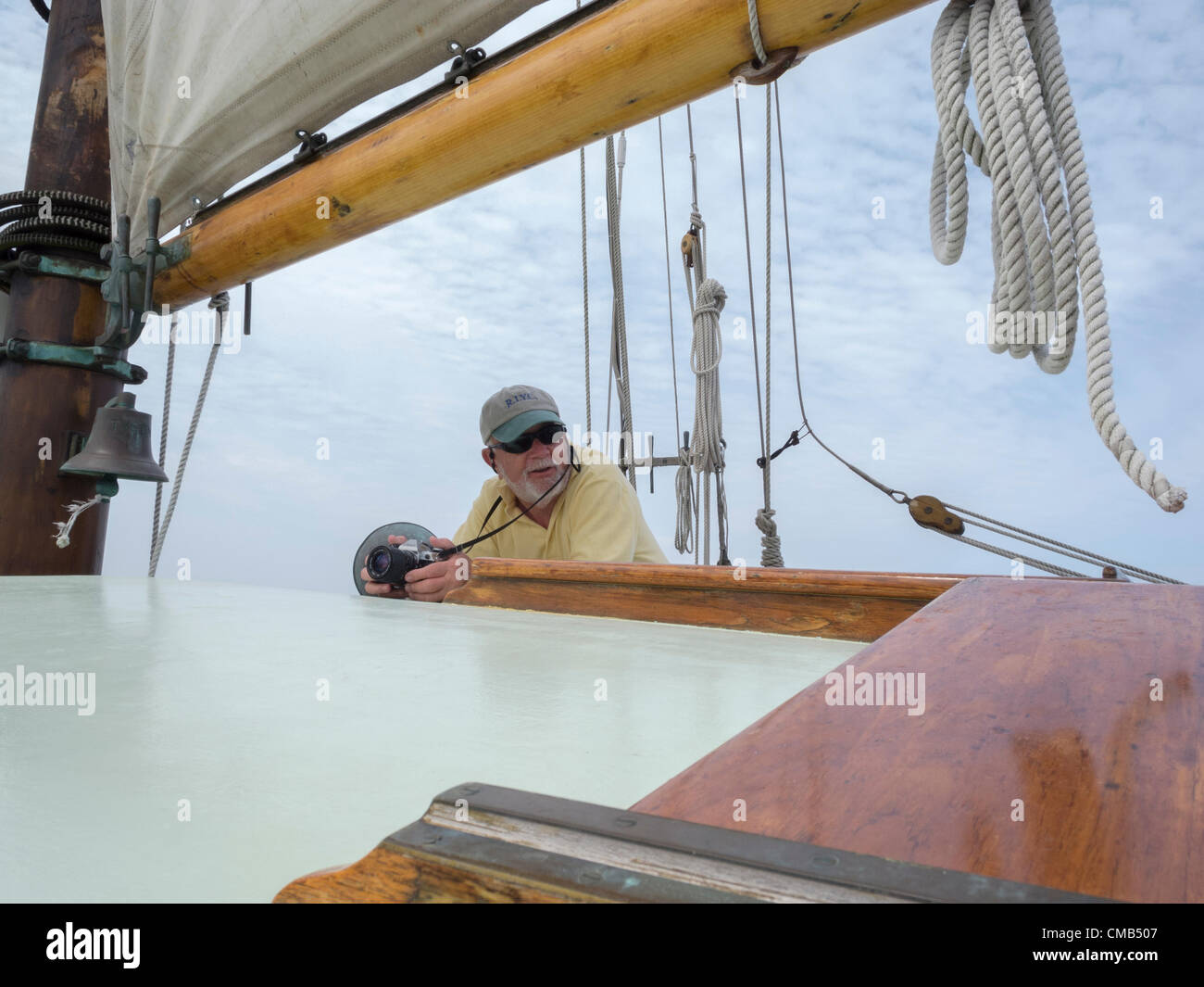 Roger Sherman aboard the tall ship schooner Tyrone during the Parade of Sail, Day 2 of OpSail Connecticut 2012. - Stock Image