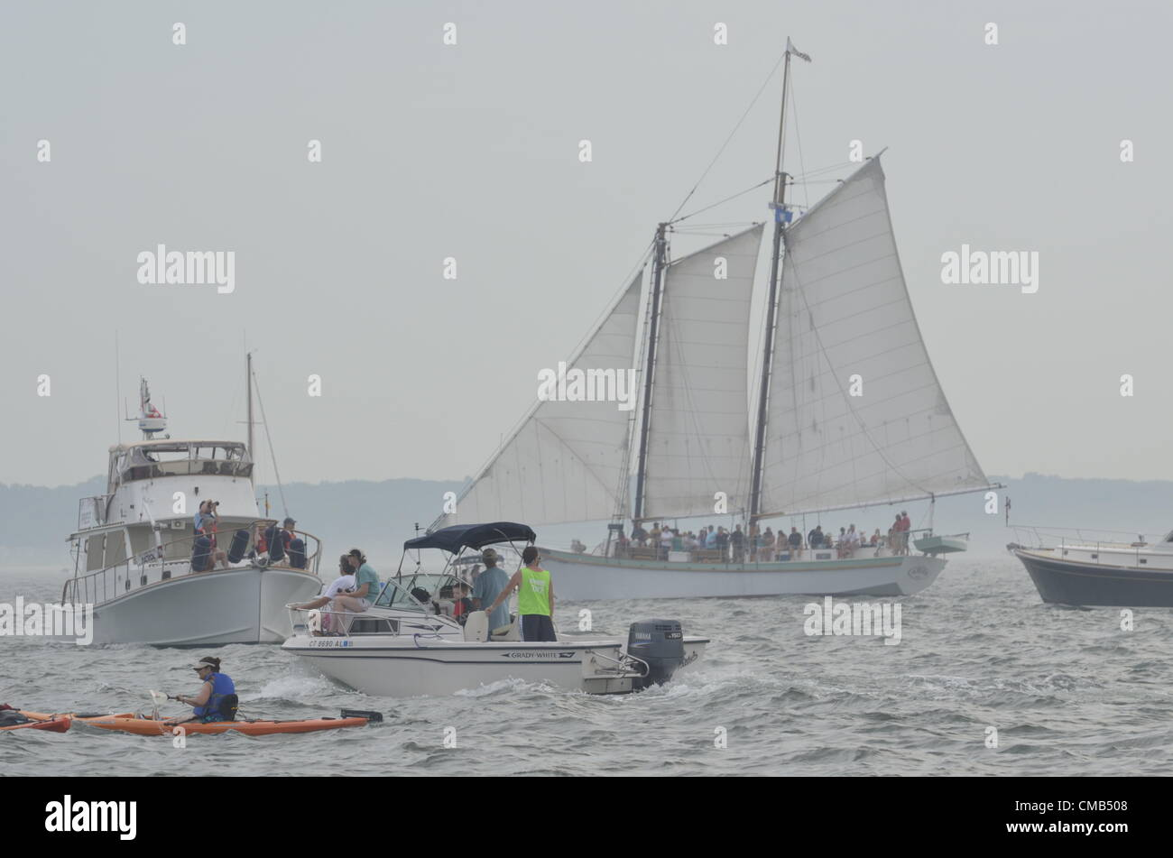 The Argia, a two-masted gaff topsail schooner from Mystic, Connecticut under sail as the Parade of Ships prepares - Stock Image