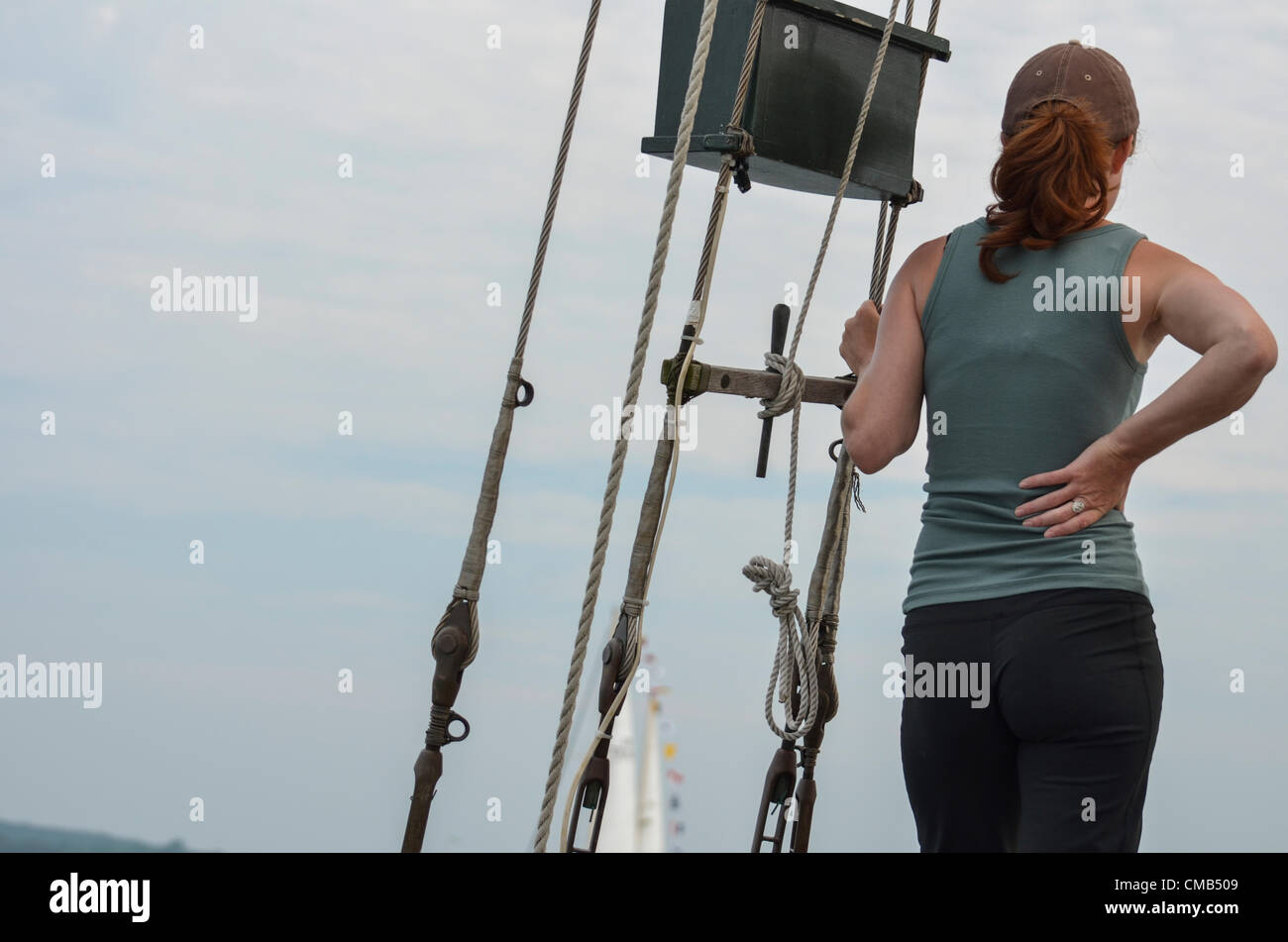Alyssa Grinberg, from Boston, Massachusetts, a sailor on the crew of the schooner Tyrone, a tall ship from Chatham - Stock Image