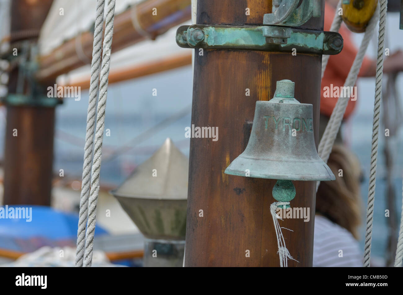 Brass bell on the tall ship schooner Tyrone during the Parade of Sail OpSail 2012 Connecticut. The Tyrone hails - Stock Image
