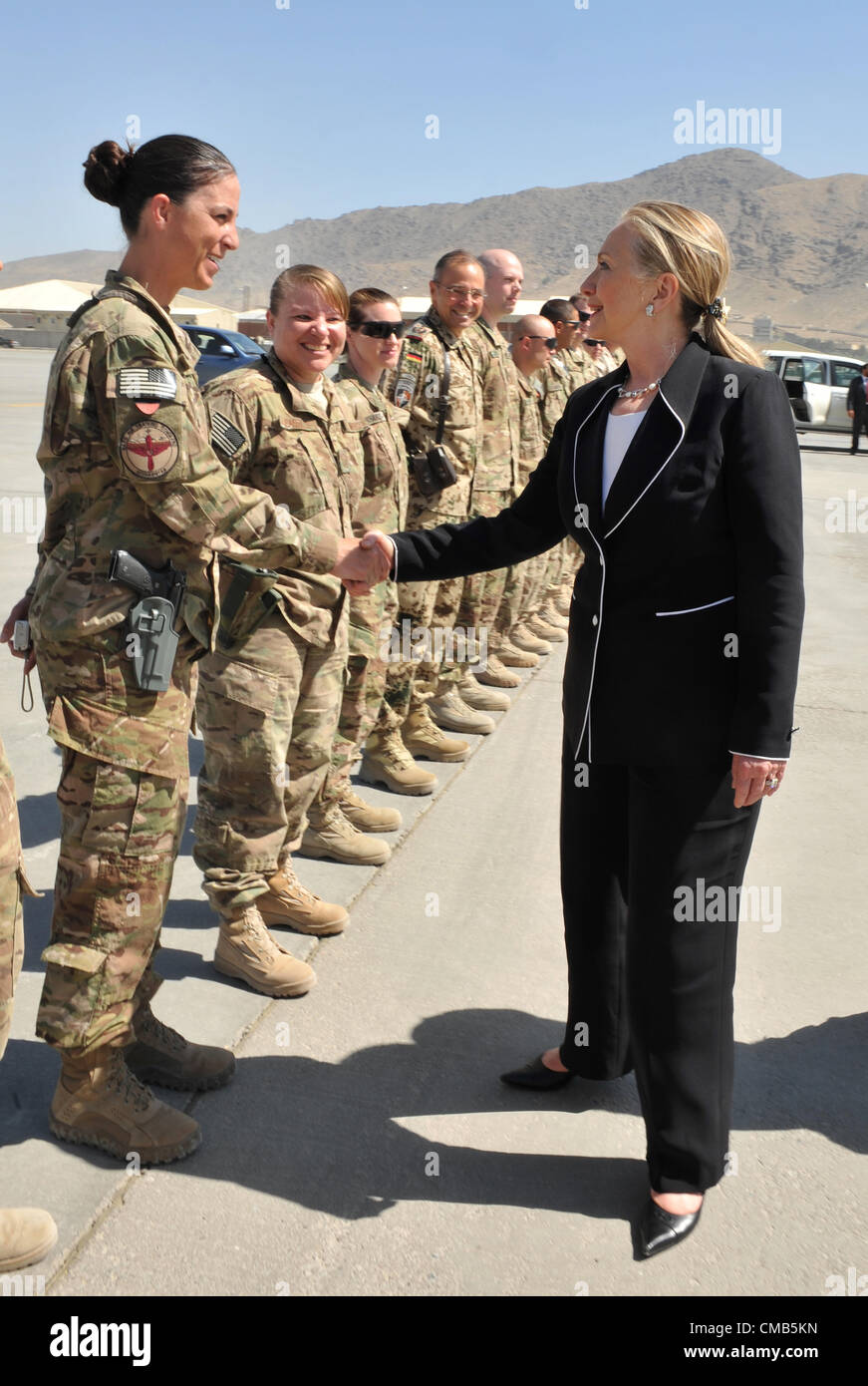 us secretary of state hillary rodham clinton greets a us airman