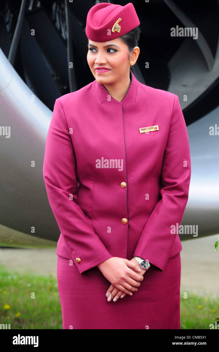 Farnborough, UK. Monday 9th July 2012.  Air stewardess welcoming guests to view the Qatar Airlines Boeing 787 'Dreamliner' - Stock Image