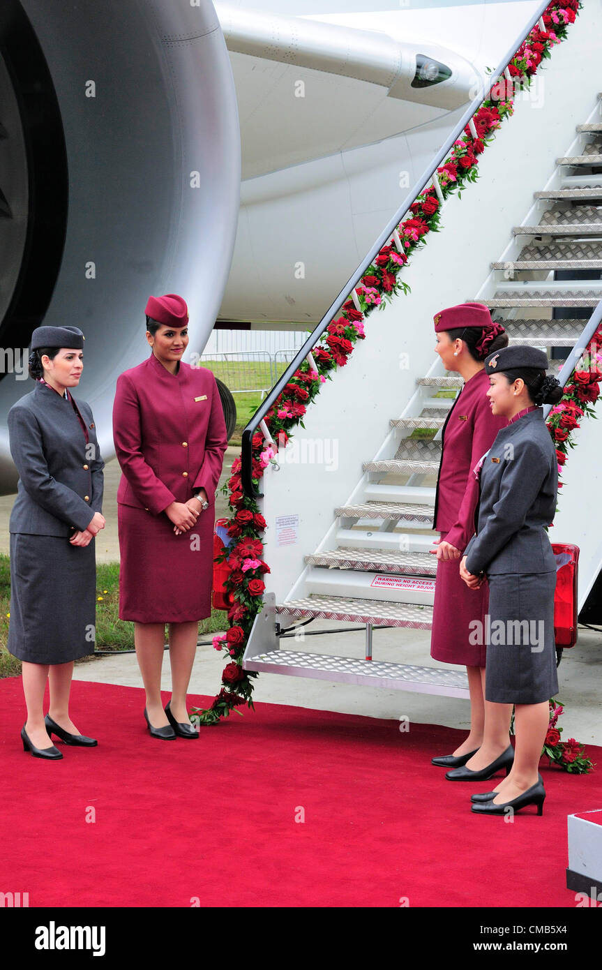 Farnborough, UK. Monday 9th July 2012.  Cabin crew awaiting guests to view the Qatar Airlines Boeing 787 'Dreamliner' - Stock Image