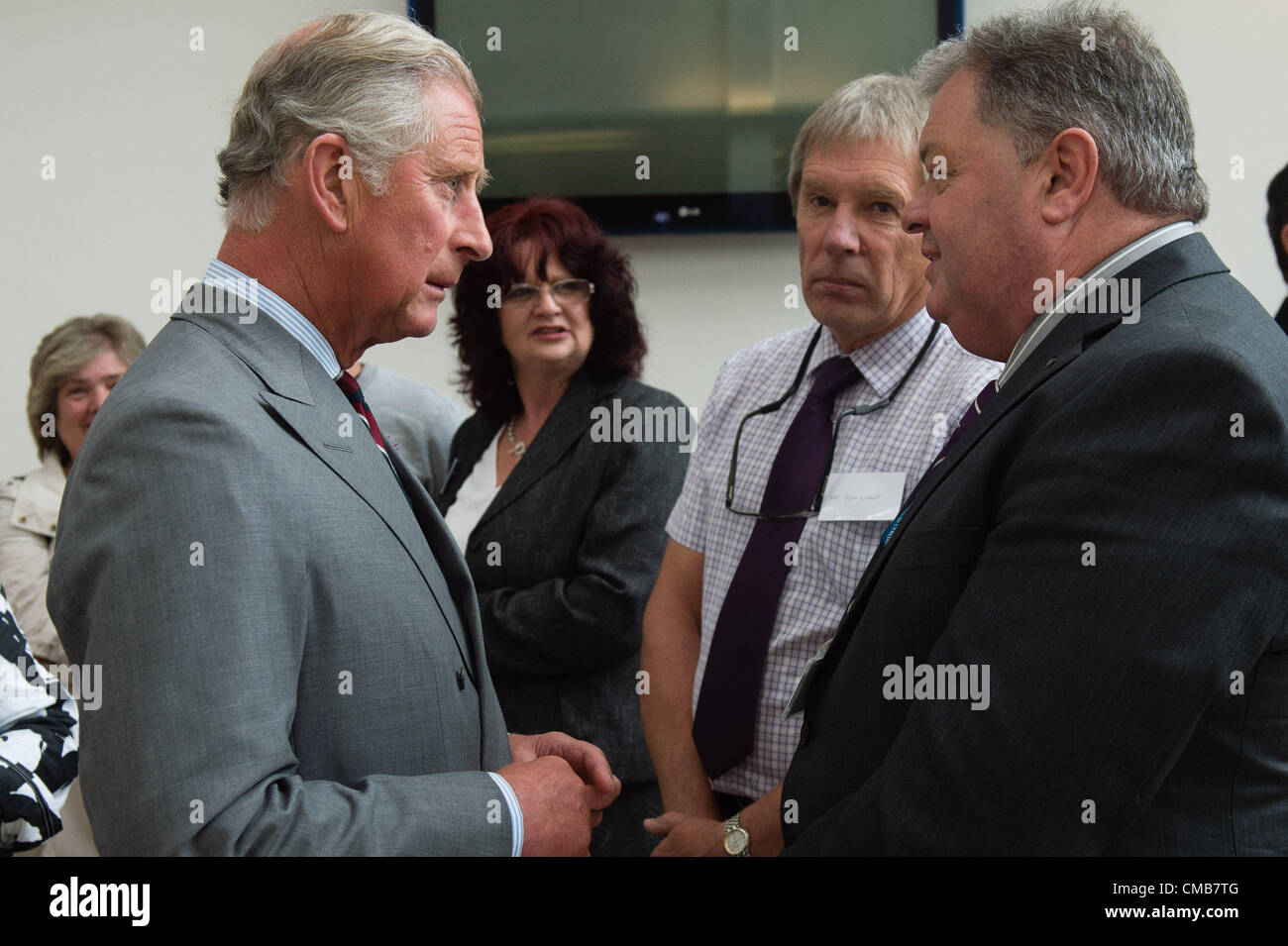 July 9 2012  Prince Charles and the Duchess of Cornwall meet victims of June's floods,  members of the emergency - Stock Image