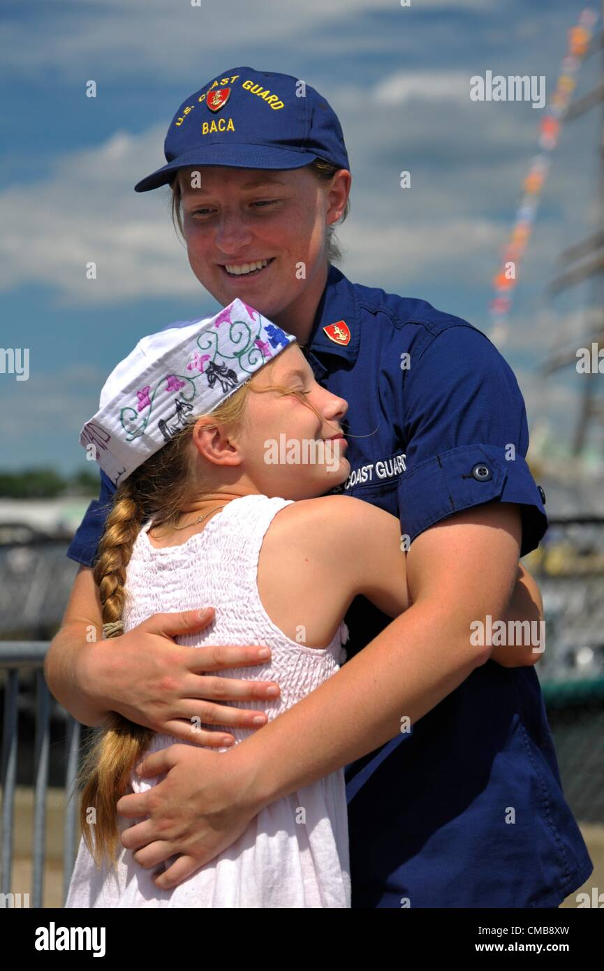 New London, Connecticut, USA - July 9, 2012: Nine-year-old Amelia Baca greets her sister, United States Coast Guard - Stock Image