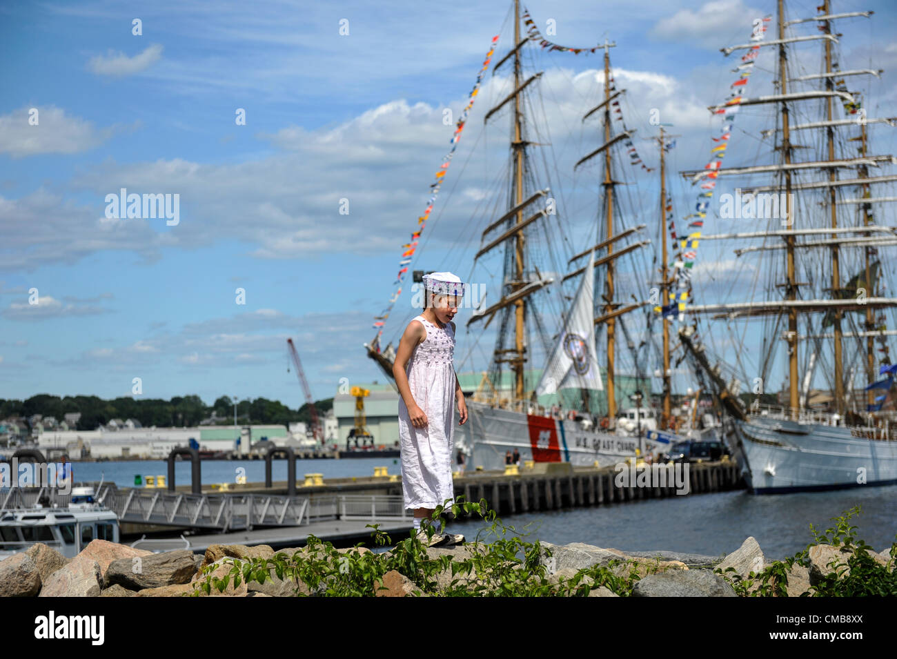 New London, Connecticut, USA - July 9, 2012: Nine-year-old Amelia Baca in sailor cap visiting her sister, United - Stock Image
