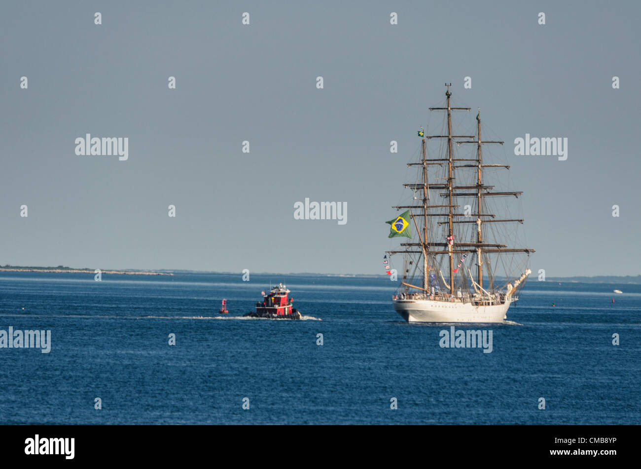 New London, Connecticut, USA - July 9, 2012: The Brazilian tall ship Cisne Branco with signal flags and the flag - Stock Image