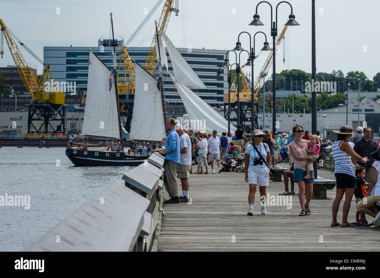 New London, Connecticut, USA - July 9, 2012: Crowds gather to see the tall ships sail away from Fort Trumbull to - Stock Image