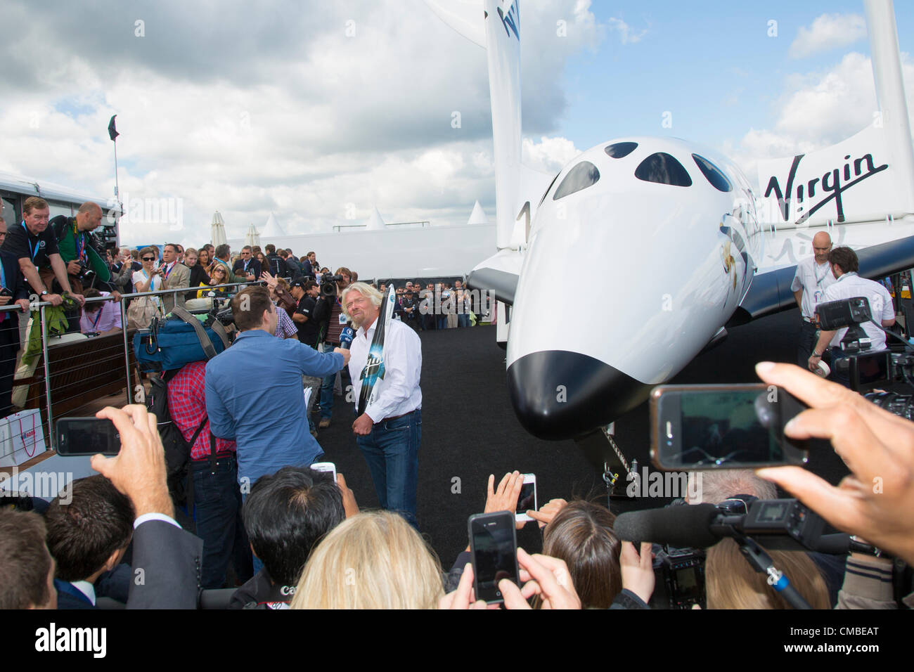Farnborough, UK. 11th July, 2012. Sir Richard Branson's Virgin Galactic spaceship makes its UK debut at the - Stock Image