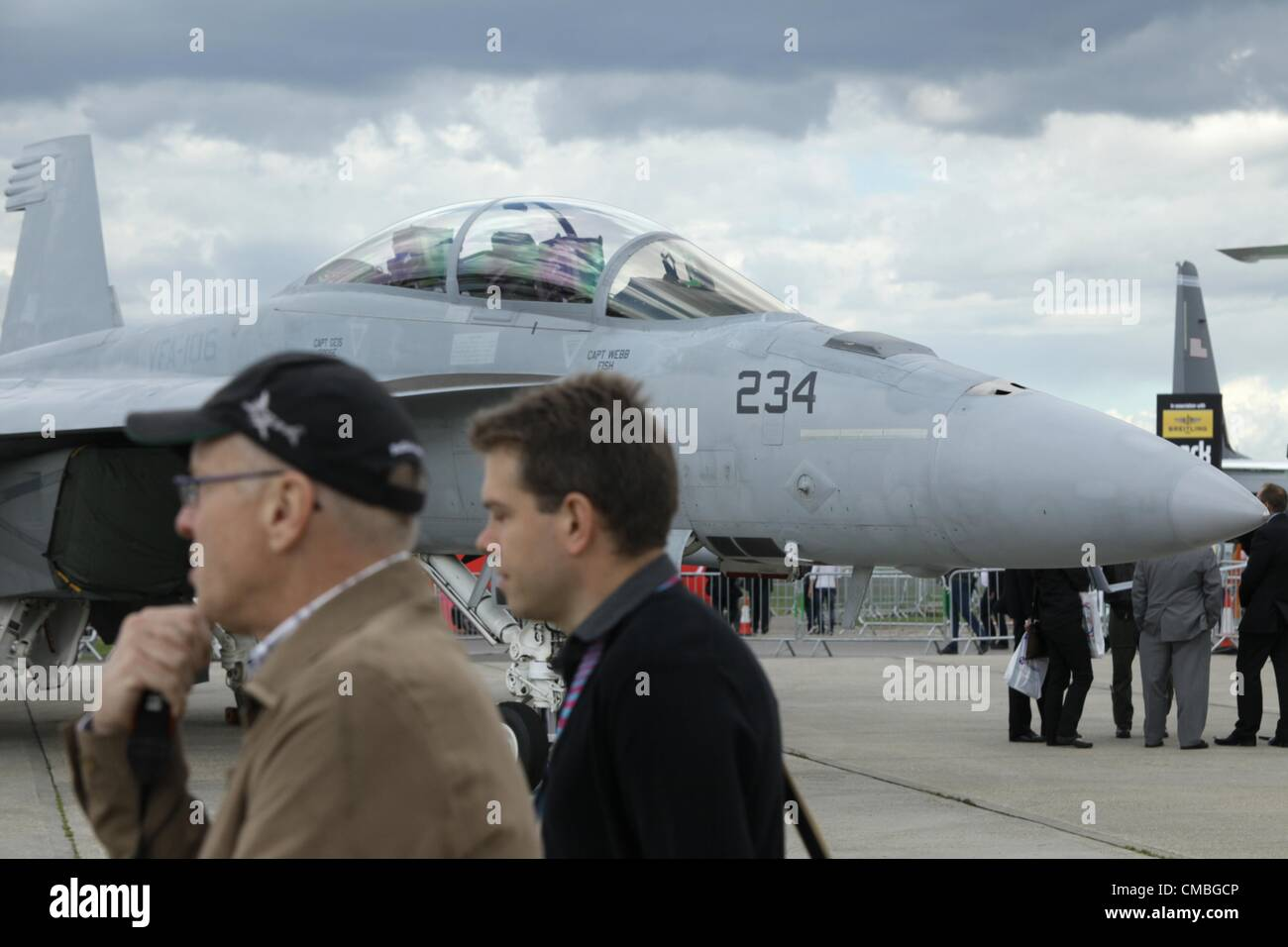 11 June 2012. Farnborough International airshow.  Pictured visitors walk pass an F-16C/D - Stock Image