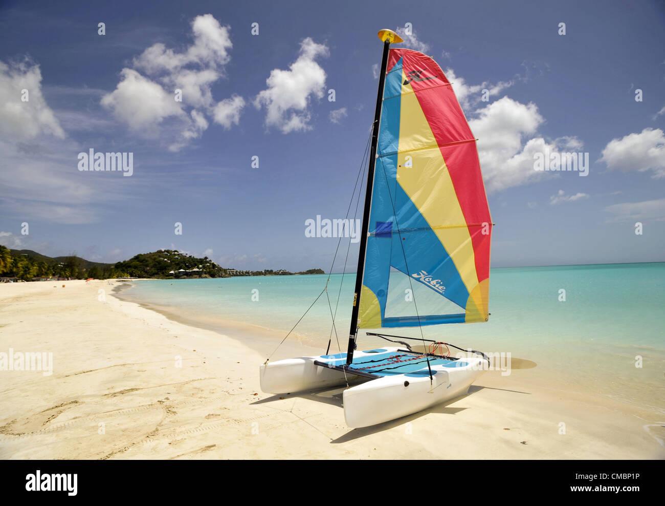 June 19, 2012 - Jolly Beach, Antigua, U.S. - A Hobi Cat sail boat sits ready for action on Jolly Beach on the Caribbean - Stock Image