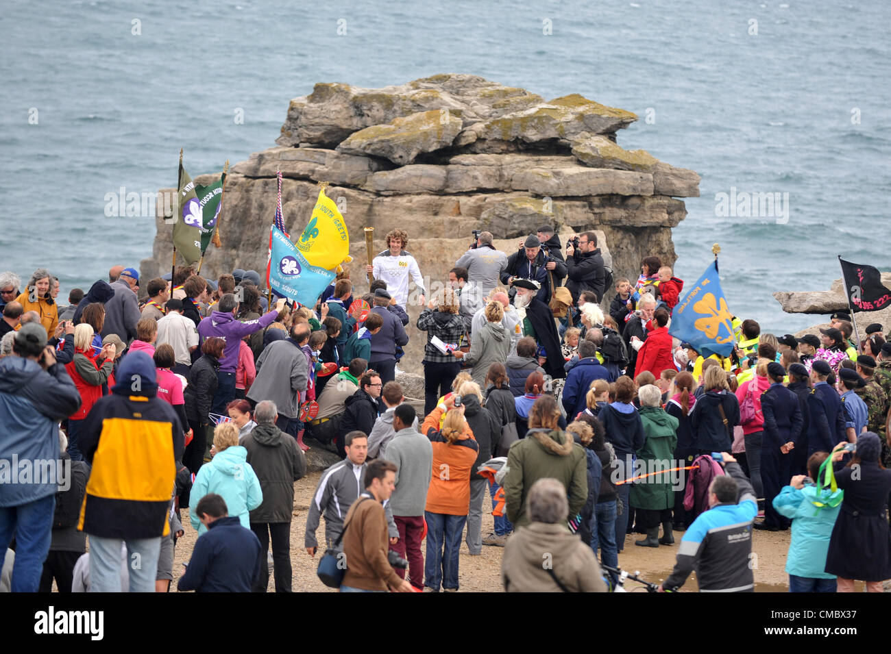 Day 56 of the torch relay around the UK…Pulpit Rock at Portland Bill, Dorset this morning as the first torch was - Stock Image