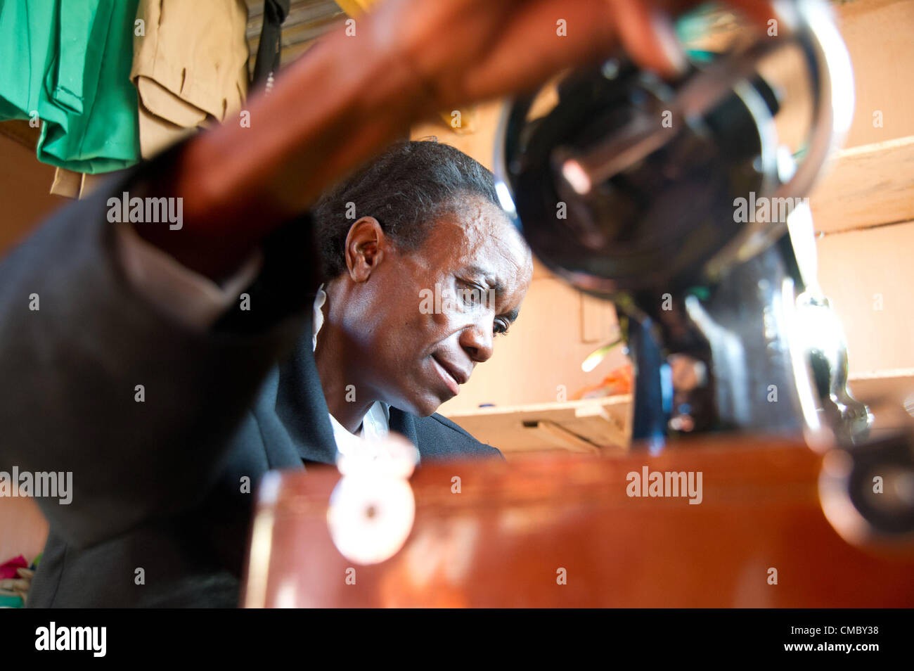 June 7, 2012 - Madabe (Village, Zimbabwe - June 7, 2012, Mangwe, Zimbabwe - Seen here working at her sewing machine, - Stock Image