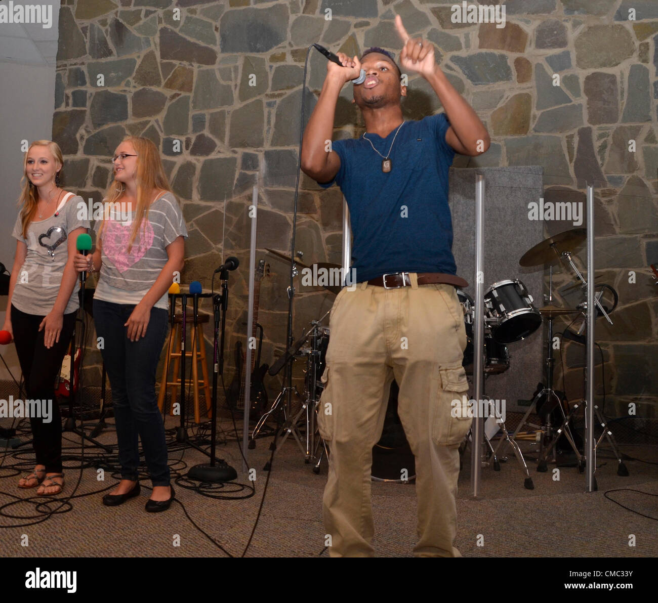 Riverdale Park, Md USA July13, 2012... Benefit Concert...  Gospel Rapper Phresh Air teams with gospel singers Anna - Stock Image