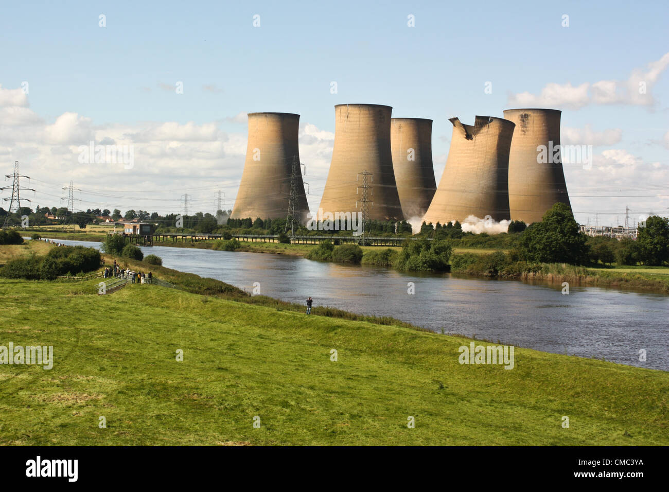 The first cooling tower begins to collapse in the demolition process at High Marnham, Nottinghamshire, UK, at 10am - Stock Image
