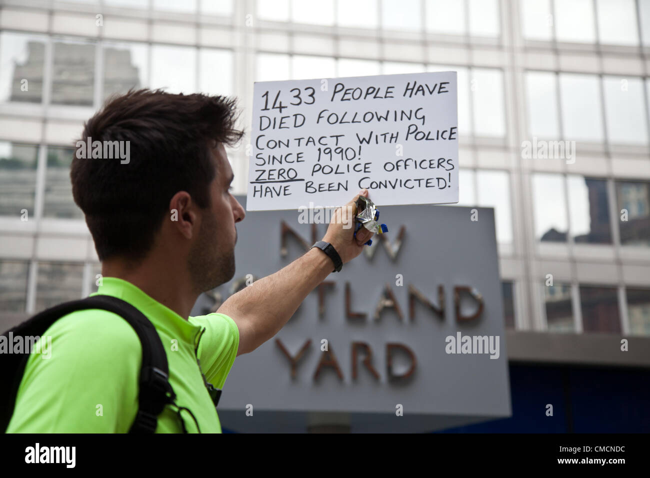 London, UK. 19th July 2012 A sign being held up by one of the protestors gathered outside Scotland Yard in Westminster - Stock Image