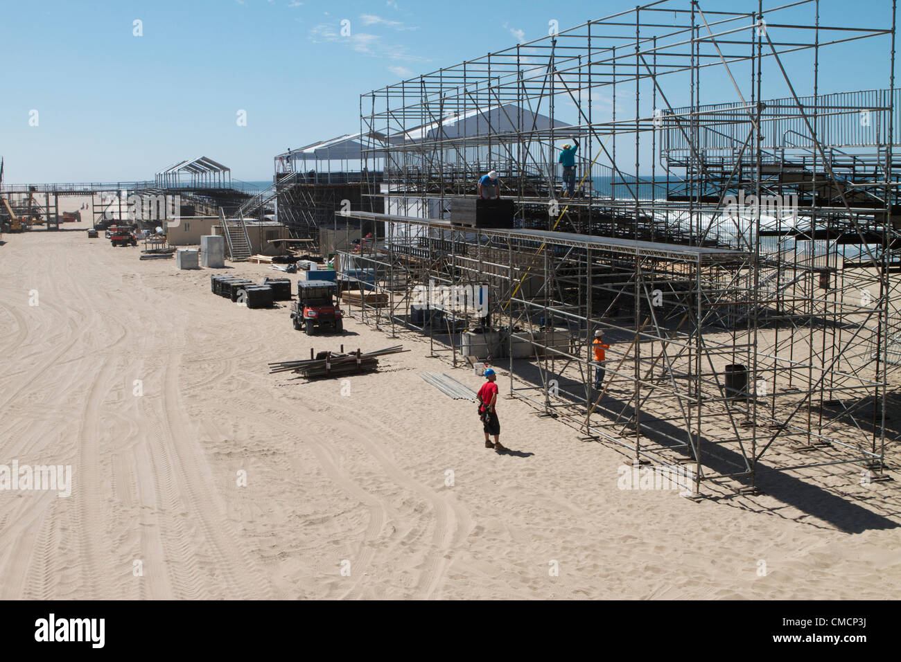 July 19th 2012  Construction crews work on erecting the stands, stadiums ,seating and bleachers south of Huntington Stock Photo