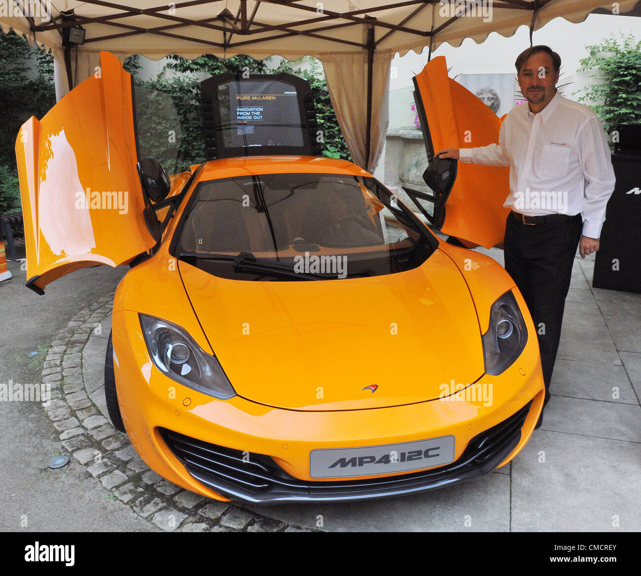 Michael Roeck Of Austrian Firm Denzel Vienna Shows Car McLaren MP4 12C  Spider At Hotel