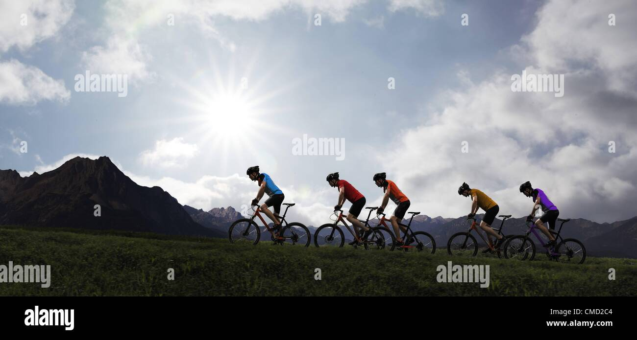08.11.2011. Germany. Model released picture of cyclists riding into the setting sun. - Stock Image