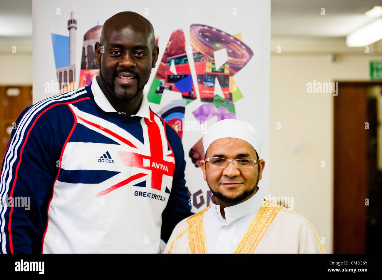 London, UK - 21 July 2012: Team GB Olympic discus thrower Abdul Buhari poses for a picture with Sheikh Khalifa Ezzat, Stock Photo