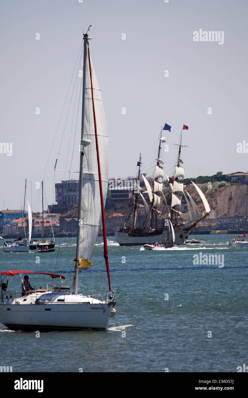 The Europa tall ship sails on the River Tagus as it departs Lisbon, Portugal. It is one of the vessels taking part - Stock Image