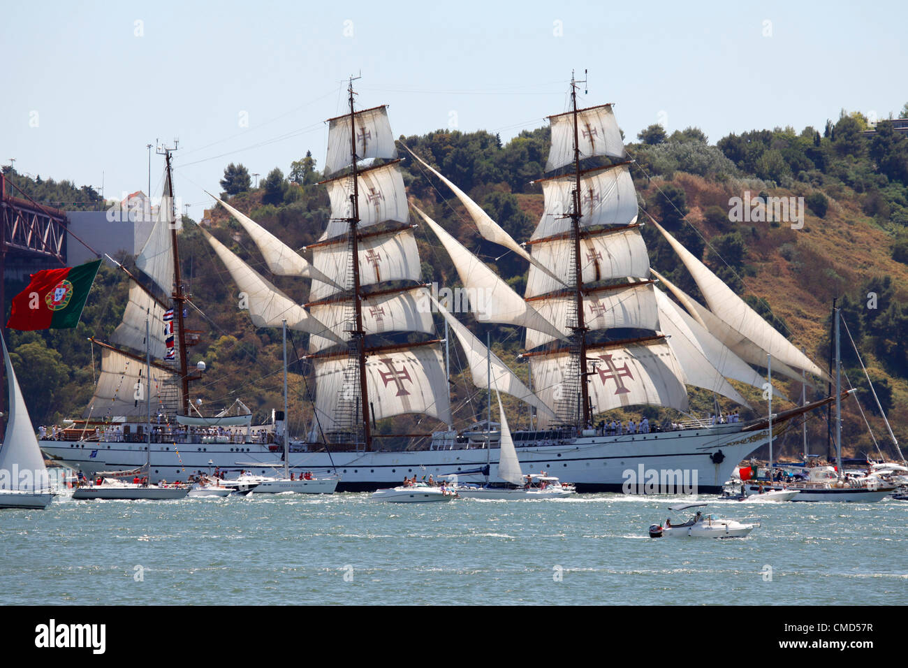 The Sagres tall ship sails on the River Tagus as it departs Lisbon, Portugal. It is one of the vessels taking part - Stock Image