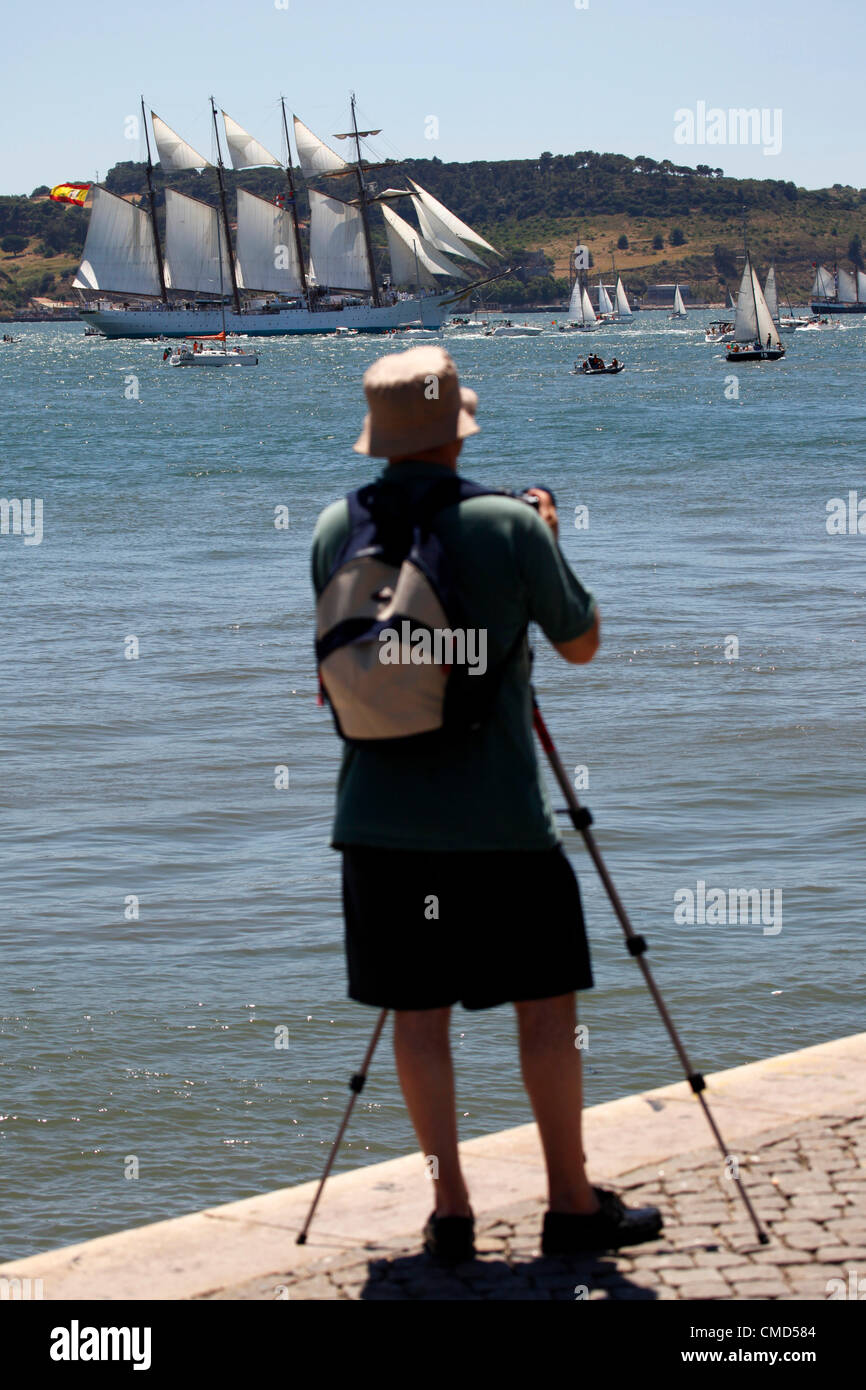 Photographers are among the gathered spectators by the River Tagus to watch the parade of the 2012 Tall Ships Race - Stock Image