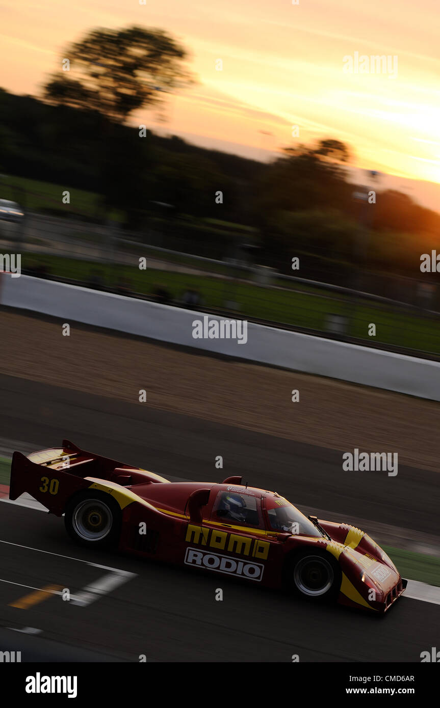 21st July 2012, Silverstone, UK.  Petter Garrod's Nissan NTPi90 races at sunset during the Group C race at Silverstone - Stock Image