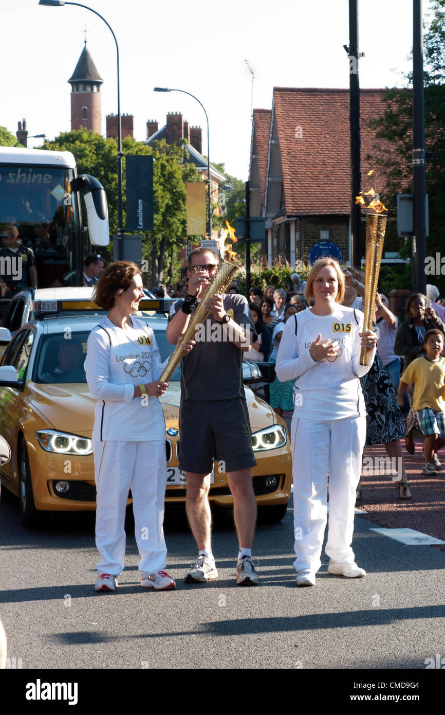 Handover of the Olympic Torch to Jaime Minter-Green (right), at Ladywell, Lewisham - Stock Image