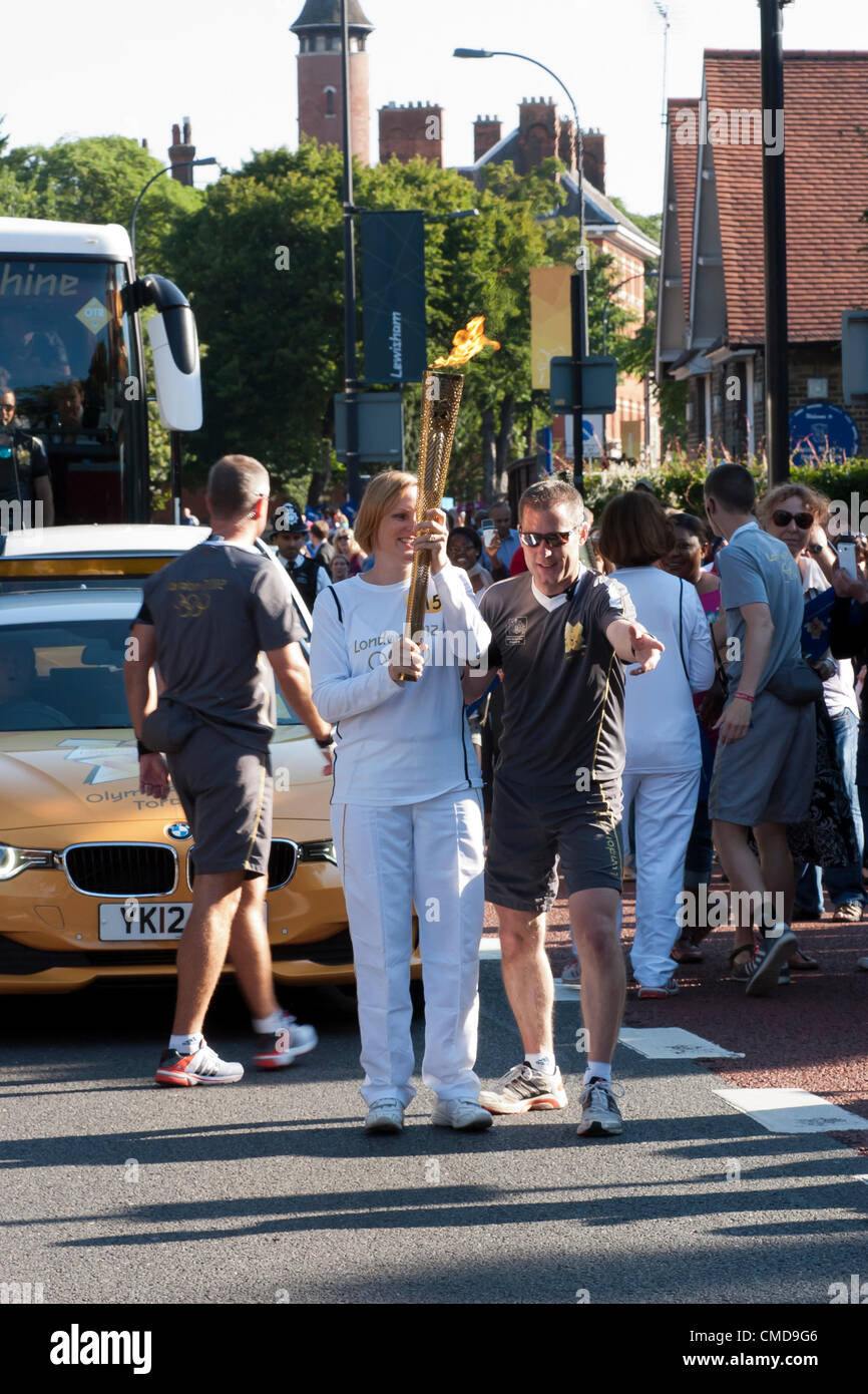 Handover of the Olympic Torch to Jaime Minter-Green's at Ladywell, Lewisham - Stock Image