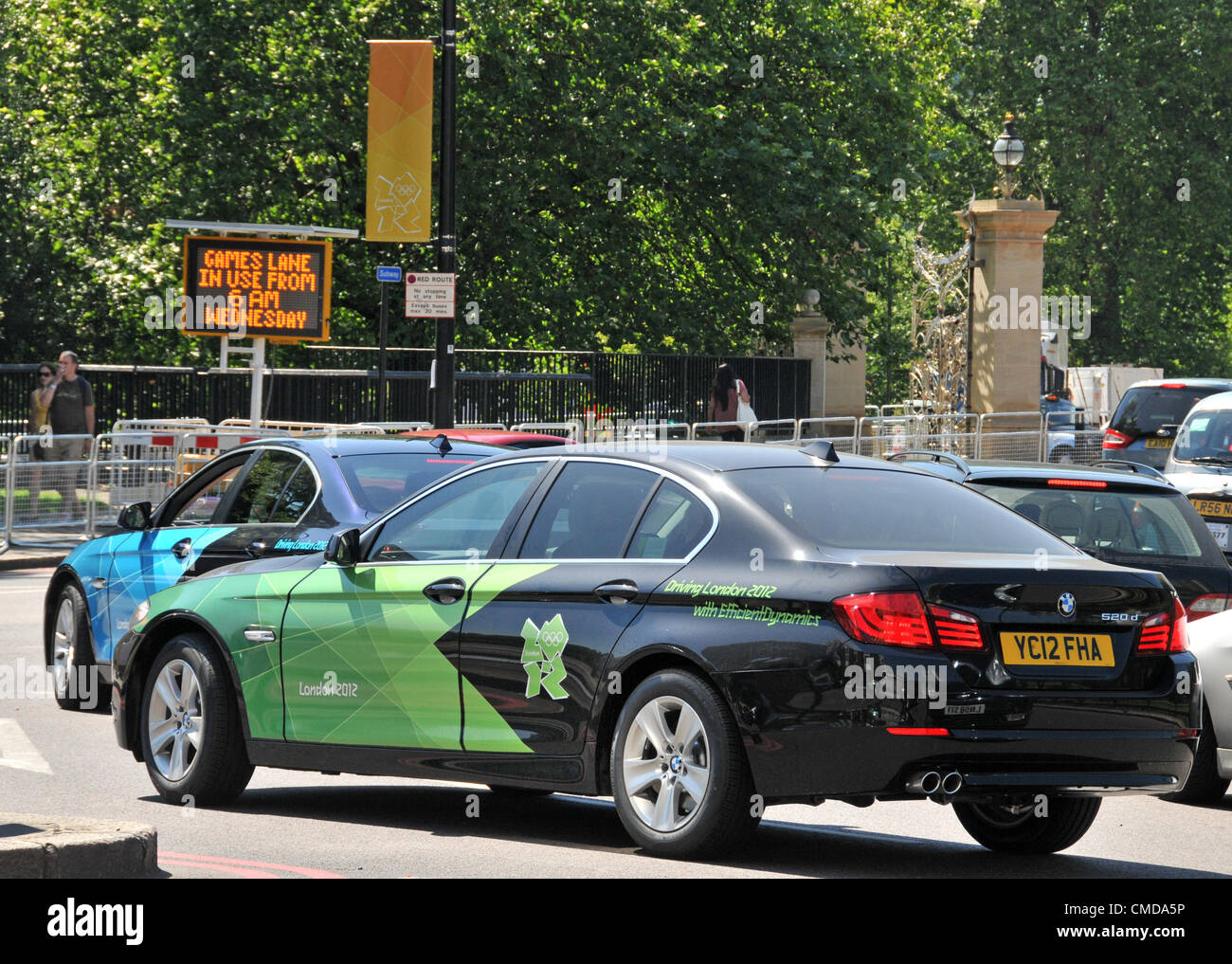 Hyde Park Corner, London, UK. 23rd July 2012. Games lane signs and official Olympic livery BMW cars are all over - Stock Image