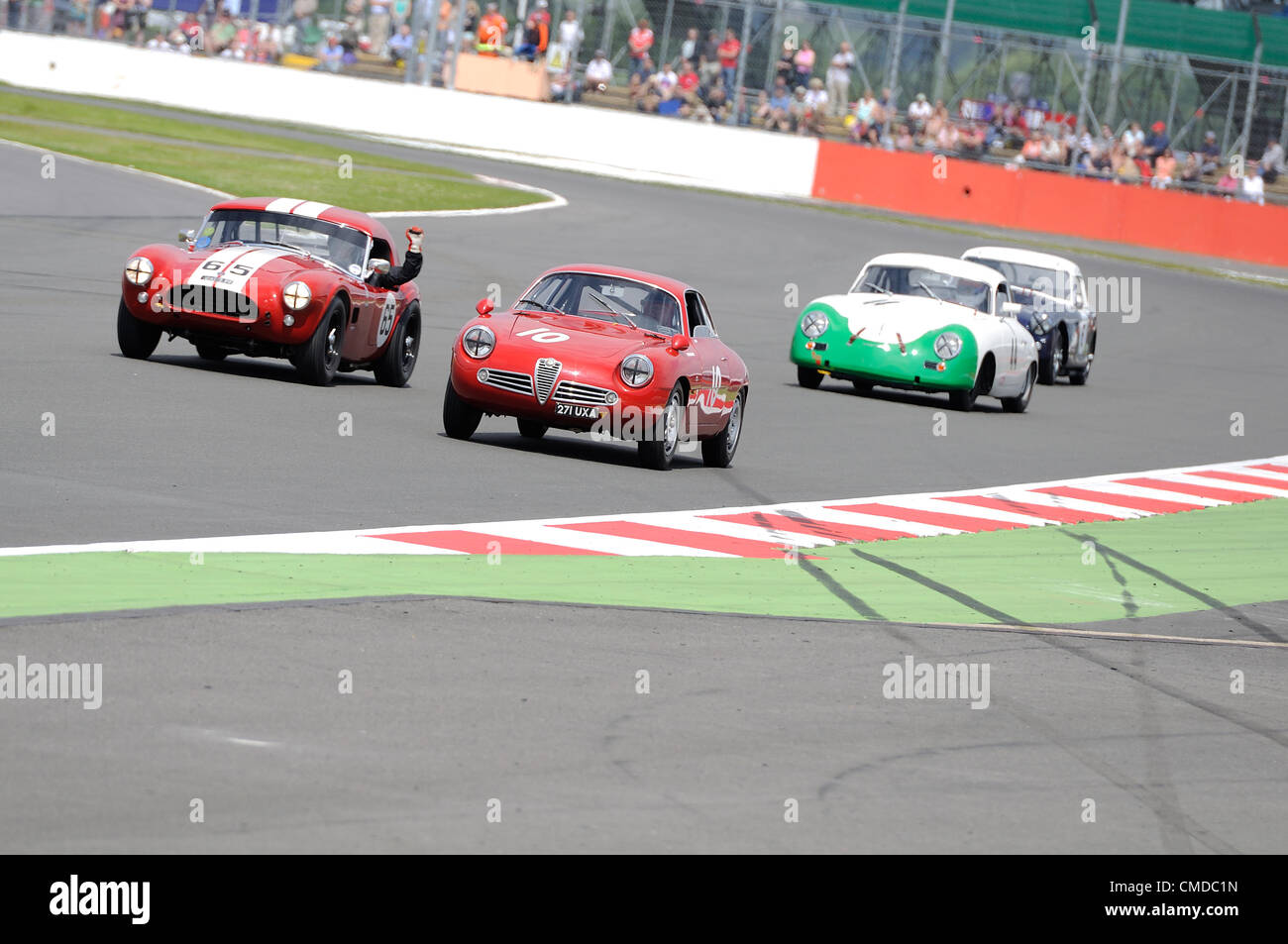 22nd July 2012, Silverstone, UK.  The driver of Martin Hunt and Patrick Blakeney-Edwards' AC Cobra getures out - Stock Image
