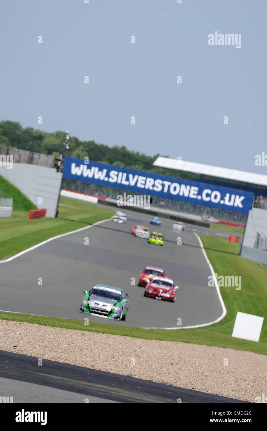 22nd July 2012, Silverstone, UK.  The cars tackle the Hangar Straight during the Fujifilm Touring Car Trophy 1970 - Stock Image