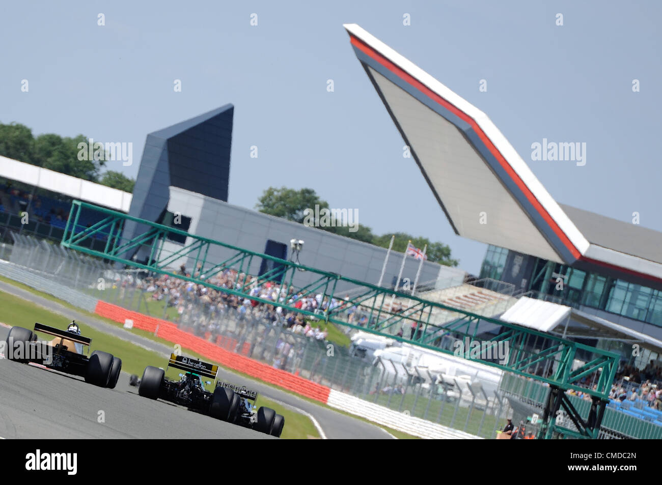 22nd July 2012, Silverstone, UK.  The historic F1 cars race for position during the Daily Express International - Stock Image
