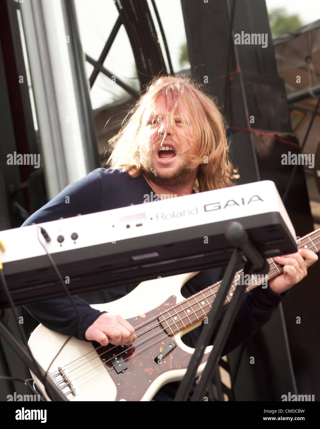 Rock star / musician Ben McKee of the alt rock  indie rock  indy rock band Imagine Dragons | Performing / playing - Stock Image