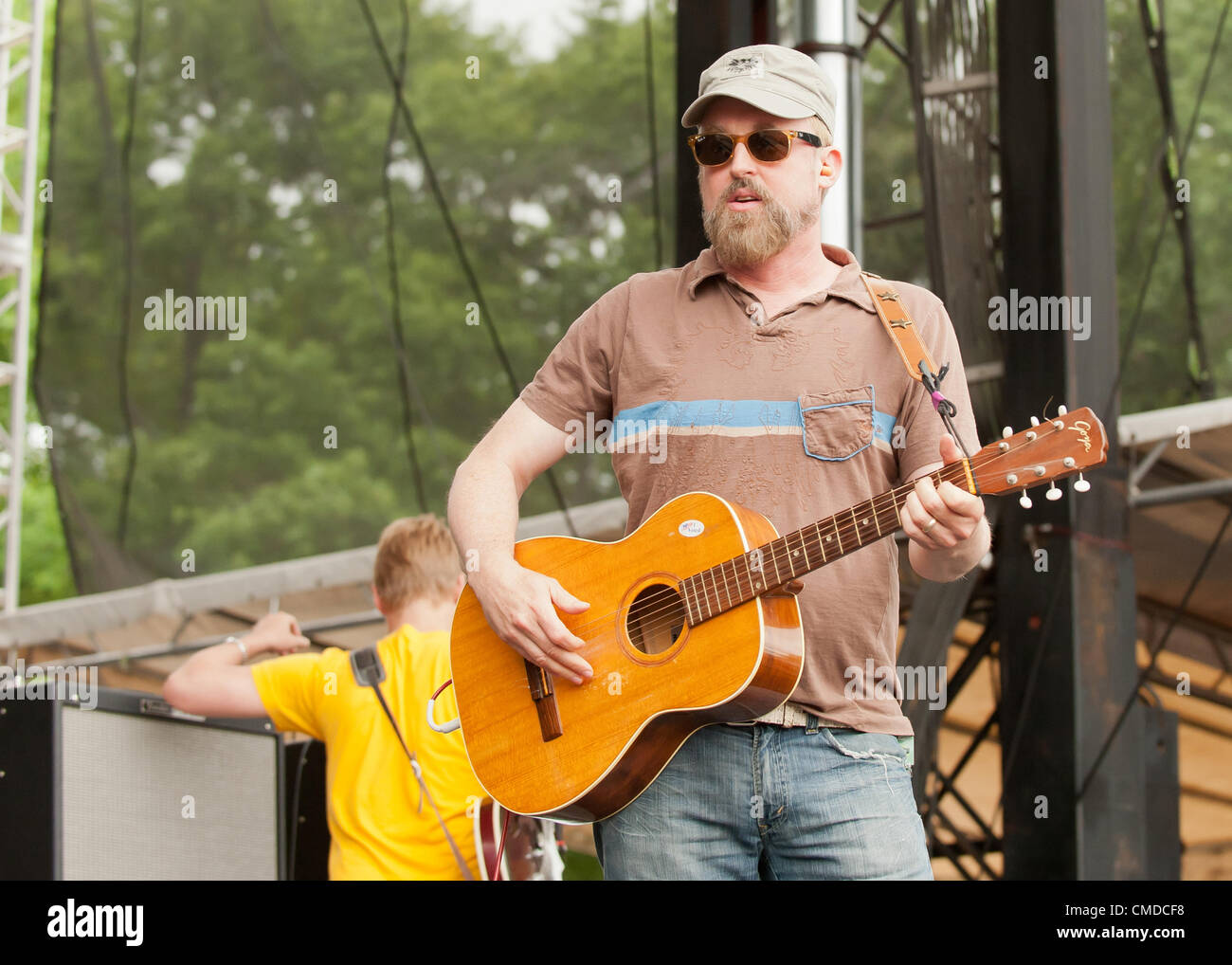 Rock star / musician John McCrea of the alt rock  indie rock  indy rock band Cake | Performing / playing guitar Stock Photo
